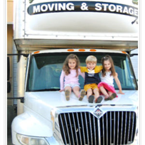kids sitting on a moving truck